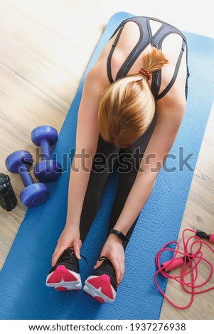 Wellness Fitness home, distance learning  virtual instructor. Woman sportswear sports.Sports and leisure concept locked fitness apps online, lockdown quarantine,stay fit,home fitness
