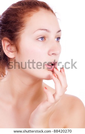 Wellness, healthcare, skin care. Lovely woman touching her lips on white backgroun.