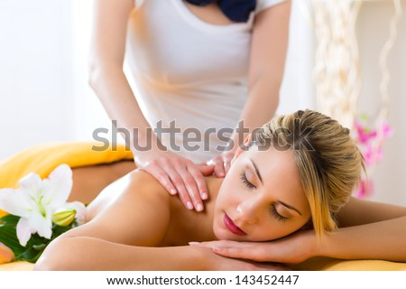 Wellness - woman receiving body or back massage in spa - stock photo