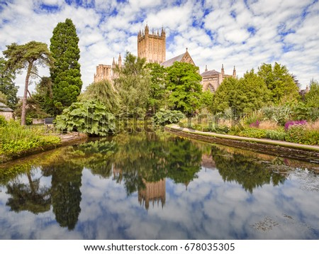 Wells Cathedral reflected in the Well Pools in the grounds of the Bishop's Palace, Wells, Somerset, England, UK.
