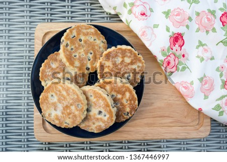 Welsh Cakes presented on a plate.