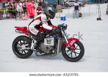 WENDOVER, UT - AUGUST 13: A 1000cc Honda motorcycle races on the Bonneville Salt Flats during Bonneville Speed Week on August 13, 2011 near Wendover, UT.