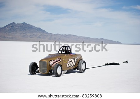 WENDOVER, UT - AUGUST 13: A 1938 Ford Roadster with its parachute deployed on the Bonneville Salt Flats during Bonneville Speed Week on August 13, 2011 near Wendover, UT. - stock photo