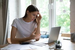 Went into debt. Annoyed young lady look on pc screen calculate too big sum of tax utility bills mortgage loan payment. Confused female self employed enterpreneur miss term to pay tax receive penalty