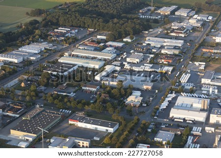WESEL, GERMANY - SEPTEMBER 9, 2012: Aerial view of industrial park Wesel-Ost I. Many companies in the sectors foods, medical engineering and computer have settled down in this industrial district.