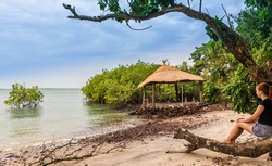 West Africa Guinea Bissau Bijagos islands Bubaque - Island de Patrone  lonely woman relaxes on a beach