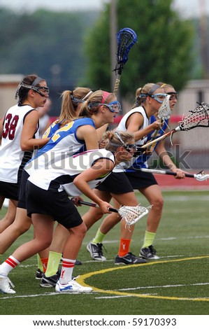 WEST CHESTER, PA - JUNE 5: Members of the Downingtown East and Radnor girls lacrosse teams prepare for a face off during a PIAA playoff game in West Chester, PA on June 5, 2010. - stock photo