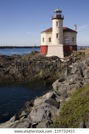 West Coast Lighthouse on a rocky jetty Colquille River Light