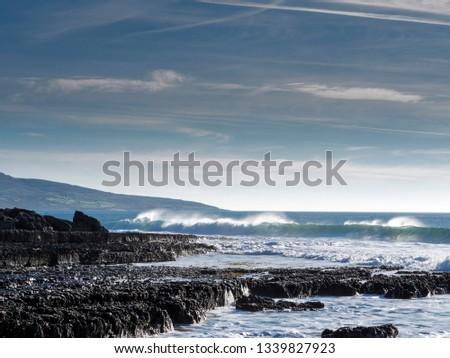 West coast of Ireland, Ocean's wave and blue cloudy sky. West coast of Ireland, county Clare. #1339827923