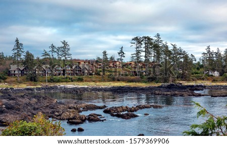 West coast of Vancouver Island near Ucluelet, Shoreside Suites l on the rocky shore of Pacific Ocean,  British Columbia Canada  Clouds, Rugged shoreline at wild pacific trail  #1579369906