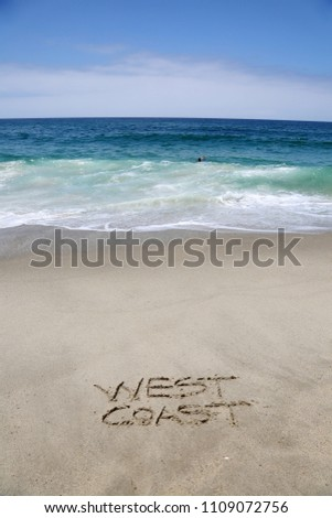 WEST COAST. The words West Coast written in sand on the beach.  #1109072756