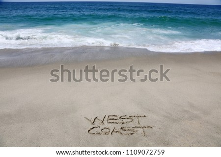 WEST COAST. The words West Coast written in sand on the beach.  #1109072759