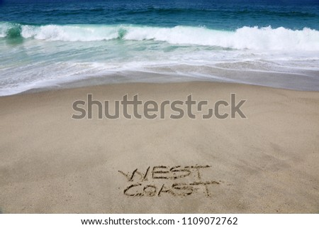 WEST COAST. The words West Coast written in sand on the beach.  #1109072762