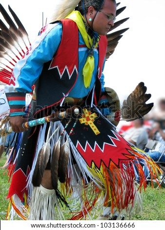 WEST FRIENDSHIP, MD - July 16, 2006: Native American Indian man dances at the Howard County Pow Wow on July 16, 2006 in West Friendship, MD - stock photo