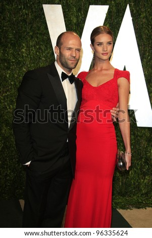 WEST HOLLYWOOD, CA - FEB 26: Jason Statham; Rosie Huntington-Whiteley at the Vanity Fair Oscar Party at Sunset Tower on February 26, 2012 in West Hollywood, California.