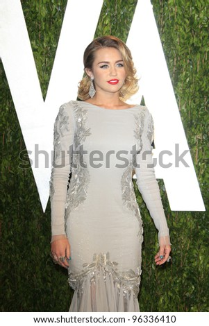 WEST HOLLYWOOD, CA - FEB 26: Miley Cyrus at the Vanity Fair Oscar Party at Sunset Tower on February 26, 2012 in West Hollywood, California.