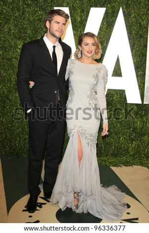 WEST HOLLYWOOD, CA - FEB 26: Miley Cyrus; Liam Hemsworth at the Vanity Fair Oscar Party at Sunset Tower on February 26, 2012 in West Hollywood, California.