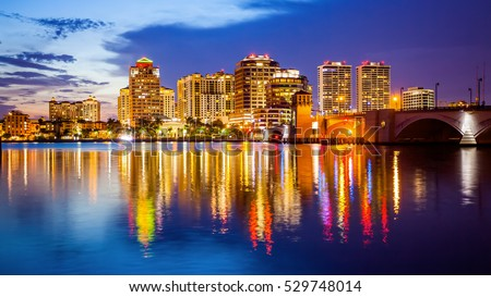 West Palm Beach, Florida skyline and city lights as night falls #529748014