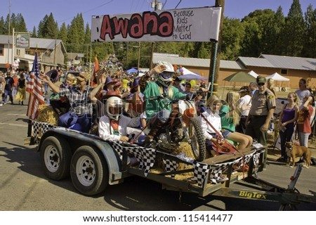 WEST POINT, CA - OCTOBER 6: Unidentified children on a float in the 38th  Lumberjack day  parade, on October 6, 2012 in West Point.