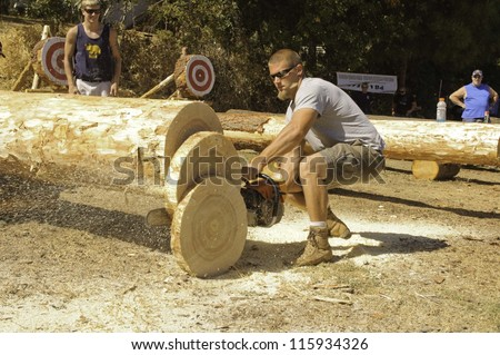 WEST POINT, CA - OCTOBER 6: Unidentified competitor in the men\'s chainsaw log cutting event at the Lumberjack day, on October 6, 2012 in West Point. West Point celebrates it\'s 38th Lumberjack day.