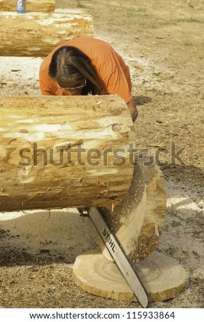 WEST POINT, CA-OCTOBER 6: Unidentified competitor in the woman\'s chainsaw event at Lumberjack day, on October 6, 2012 in West Point. West Point celebrates it\'s 38th Lumberjack day.