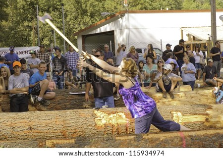 WEST POINT, CA - OCTOBER 6: Unidentified competitors in axe throwing event at the Lumberjack day, on October 6, 2012 in West Point. West Point celebrates it\'s 38th Lumberjack day.