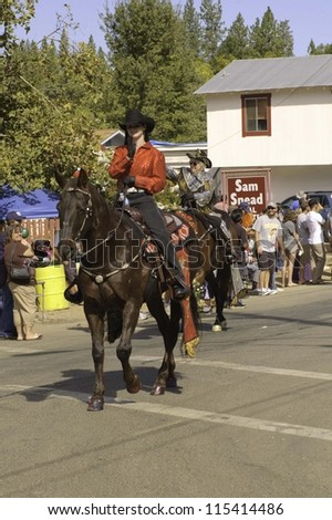WEST POINT, CA - OCTOBER 6: Unidentified horseback woman in the 38th  Lumberjack day  parade, on October 6, 2012 in West Point.