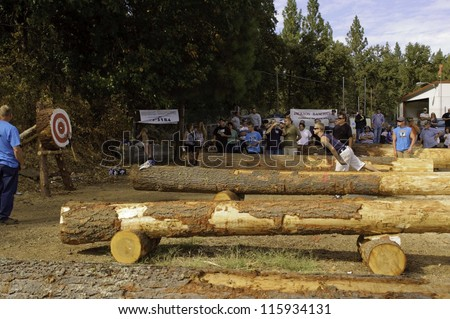 WEST POINT, CA - OCTOBER 6: Unidentified male & female competitors in the axe throwing event at the Lumberjack day, on October 6, 2012 in West Point. West Point celebrates it\'s 38th Lumberjack day.