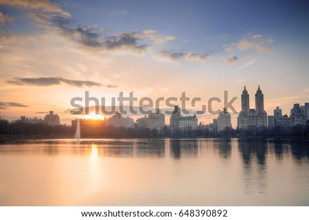 West side Manhattan's skyline as seen from Central Park's Onassis Reservoir #648390892