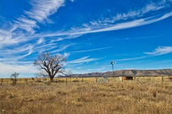 West Texas ranch land with windmill and corrals