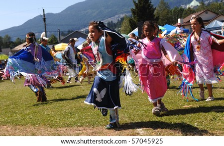 WEST VANCOUVER, BC, CANADA - JULY 10: Native Indian girls dance during annual Squamish Nation Pow Wow on July 10, 2010 in West Vancouver, BC, Canada