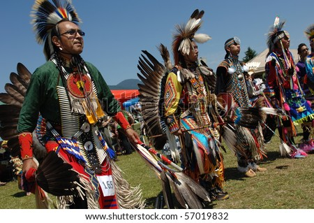 WEST VANCOUVER, BC, CANADA - JULY 10: Native Indian men participate in annual Squamish Nation Pow Wow on July 10, 2010 in West Vancouver, BC, Canada - stock photo