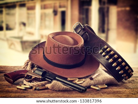 western accessories on wooden...