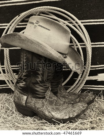 Western boots and hat - stock photo