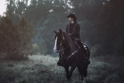 Western - cowboy portrait in forest
