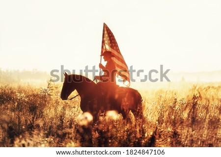 Western - cowboy portrait with USA flag