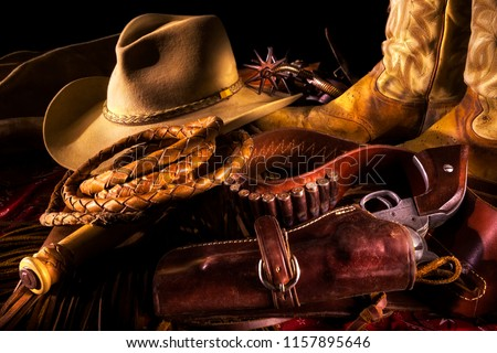 Western Cowboy Still Life with Gun, Hat, Boots, Spurs and Whip