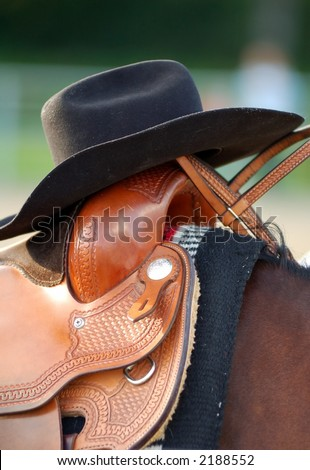 western hat on a saddle