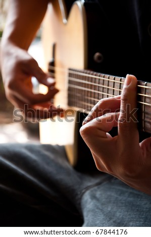 western musican with guitar in hand - stock photo