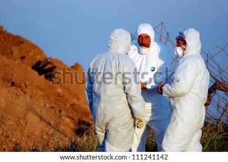 WESTERN NEGEV, ISRAEL - MARCH 18: Agriculture Ministry are burying the carcasses of dead turkeys due to Bird Flu outbreak at Kibbutz En Hashlosha in the western Negev, Israel on March 18, 2006.