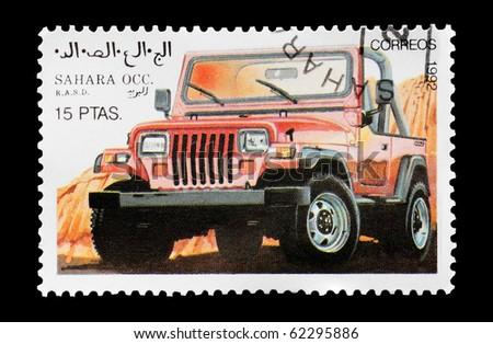 WESTERN SAHARA - CIRCA 1992: mail stamp printed in Western Sahara featuring an off-road 4x4 vehicle, circa 1992