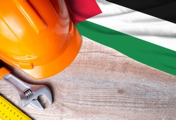 Western Sahara flag with different construction tools on wood background, with copy space for text. Happy Labor day concept.