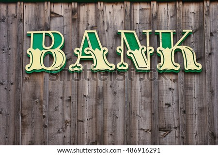 western style bank sign on...