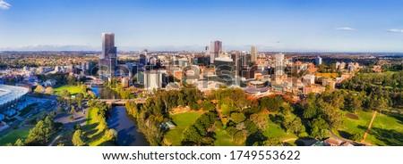 Western Sydney Parramatta CBD aerial panorama towards distant Sydney city CBD on the horizon.