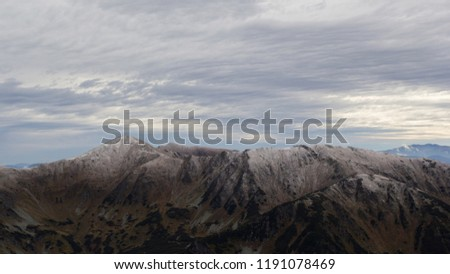 Western Tatras (Tatra Mountains in Poland) panoramic view from top of a mountain and hiking trail in autumn. Slovakia and Poland landscape #1191078469