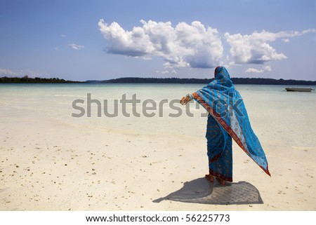Western woman wearing a saree on the beach. Havelock island, Andamans, India - stock photo