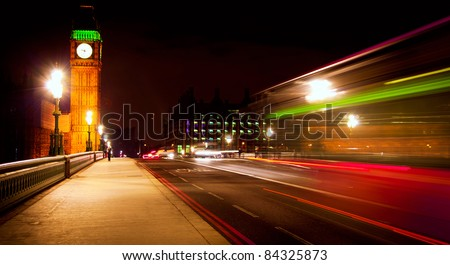 Westminster Bridge in London at night with Big Ben and bus