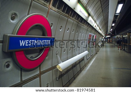 WESTMINSTER, LONDON, ENGLAND-JULY 16 : Underground Westminster tube station in London on July 16, 2006. The London Underground is the oldest underground railway in the world covering 402 km of tracks.