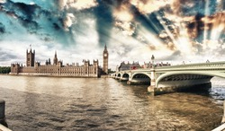 Westminster, London. View of Bridge and Houses of Parliament from across river Thames.