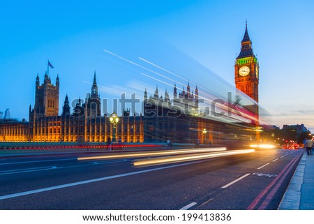 Westminster Palace and Big Ben with blue night sky and light trails of the traffic